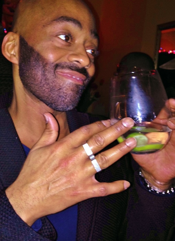 Marlon pairs the perfect holiday cocktail with the perfect double-fingered, reversible ring by Danny Fox.