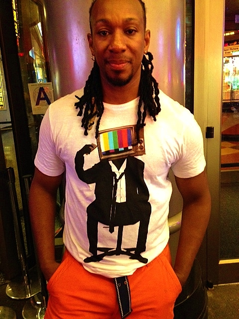 Alternative R&B singer Derek stepping out in his ARKA T-shirt in Time Square this summer.